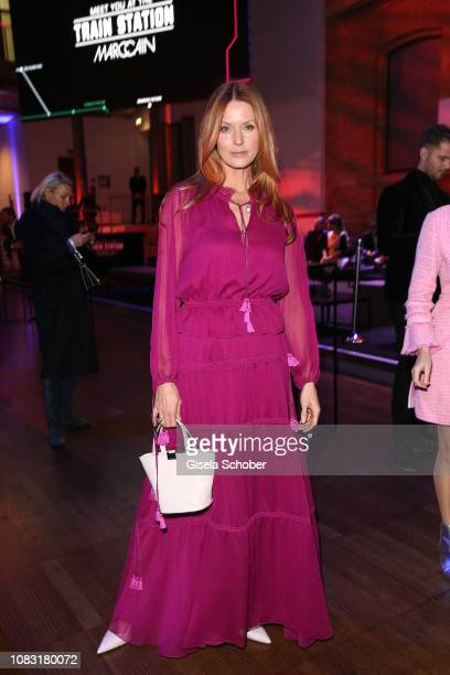 Esther Schweins wearing a purple dress by Marc Cain during the Marc Cain Fashion Show Autumn/Winter 2019 at Deutsche Telekom's representative office...