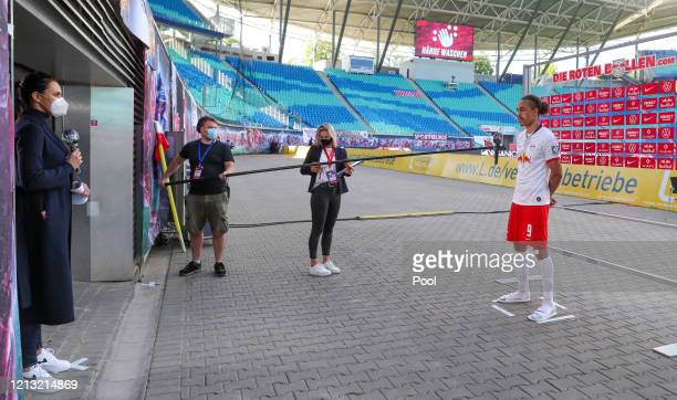 Esther Sedlaczek Sky presenter interviews Yussuf Poulsen of RB Leipzig following the Bundesliga match between RB Leipzig and SportClub Freiburg at...