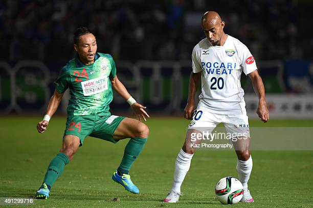 Estiven of Tokushima Vortis keeps the ball under the pressure from Hiroaki Namba of FC Gifu during the JLeague 2nd division match between FC Gifu and...