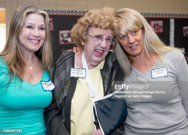 Estock Elementary alumni Karen Carlson Traywick left and Elizabeth Gaunt pose for a photo with their former teacher Joy Wright during the Helen...