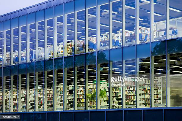 Estonia, Paernu, glass facade of Public library at twilight