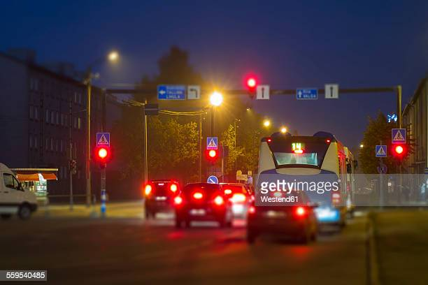 Estonia, Parnu, vehicles stopping in front of red light