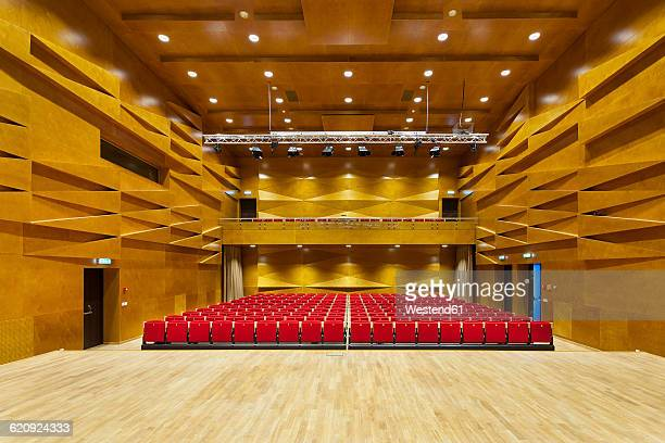 estonia, tartu, heino eller's music school, concert hall auditorium, with row of seats - コンサートホール ストックフォトと画像