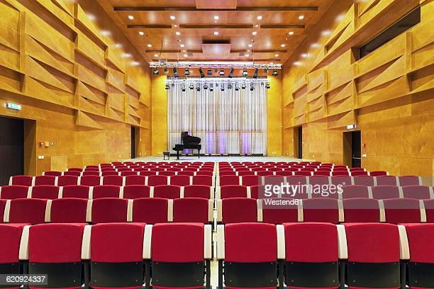 estonia, tartu, heino eller's music school, concert hall auditorium, with row of seats - concert hall stock pictures, royalty-free photos & images