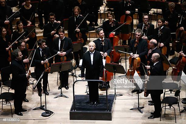 Estonian Bandmaster Paavo Jarvi and his musicians are pictured during the Philharmonie De Paris Symphonic Concert Hall opening party on January 14...