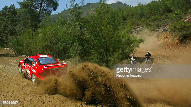 Estonian driver Markko Martin and codriver Michael Park of Great Britain take a corner in their Peugeot 307 WRC 2005 during the shakedown prior to...