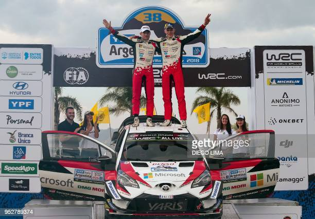 Estonian driver Ott Tanak and his compatriot codriver Martin Jarveoja celebrate their win on the final podium of the Argentina World Rally...