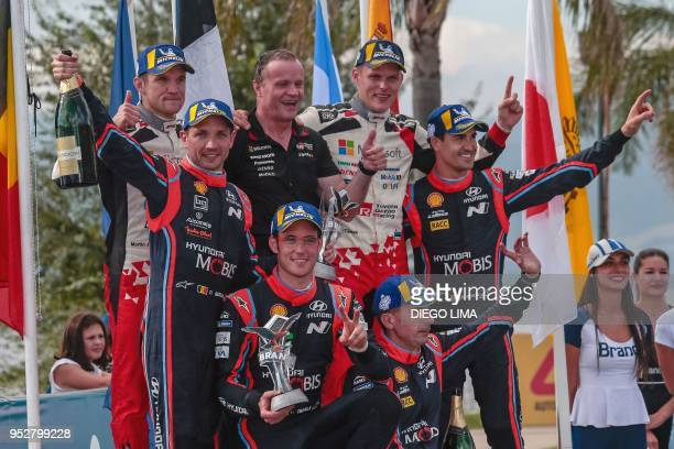 Estonian driver Ott Tanak and his compatriot codriver Martin Jarveoja celebrate their first place Thierry Neuville and codriver Nicolas Gilsoul their...