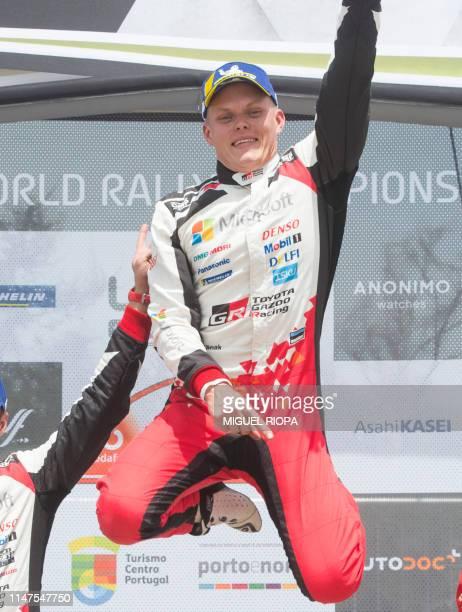 Estonian driver Ott Tanak celebrates after winning the Rally of Portugal near Fafe on June 2 2019