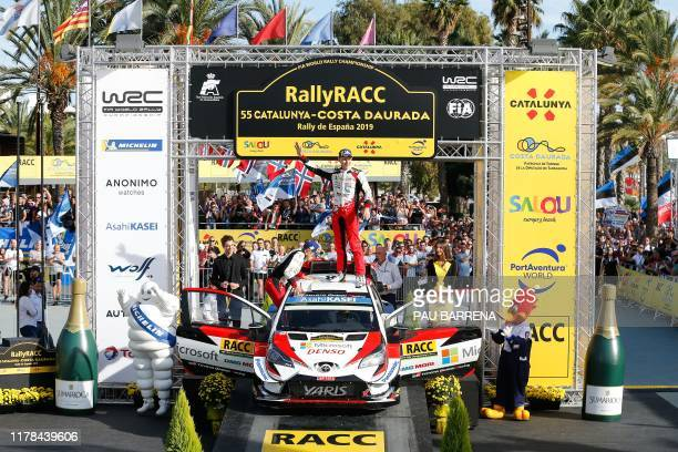 TOPSHOT Estonian driver Ott Tanak celebrates on the podium as he won the 2019 FIA World Rally Championship after finishing second on the 55th...