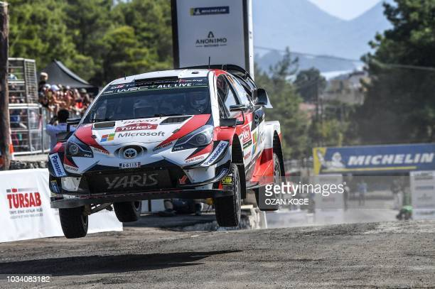 TOPSHOT Estonian driver Ott Tanak steers his Toyota Yaris i20 WRC assisted by codriver Martin Jarveoja during the fourth day of the 2018 FIA World...