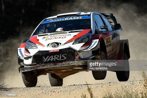 Estonian driver Ott Tanak steers his Toyota Yaris WRC assisted by Estonian co-driver Martin Jarveoja during the second day of the Catalonia 2019 FIA...