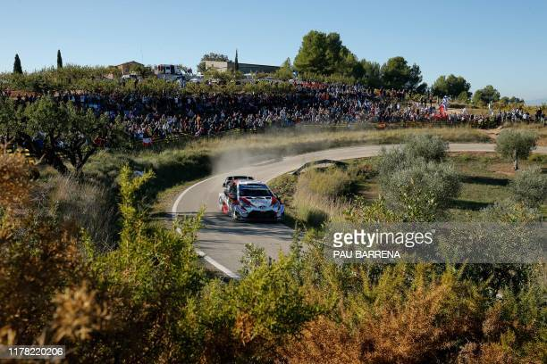 Estonian driver Ott Tanak steers his Toyota Yaris WRC assisted by Estonian co-driver Martin Jarveoja during the third day of the Catalonia 2019 FIA...