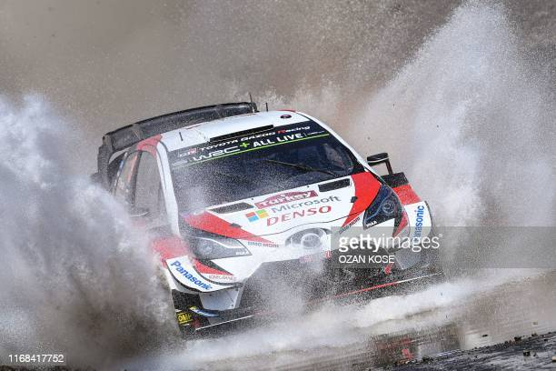 Estonian driver Ott Tanak, with co-driver Martin Jarveoja, steers his Toyota Yaris i20 WRC car during the final day of the 2019 FIA World Rally...