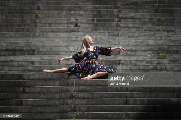 Estonian freelance ballet dancer and choreographer, Eve Mutso performs her daily fitness routine near her home Charing Cross on May 15, 2020 in...