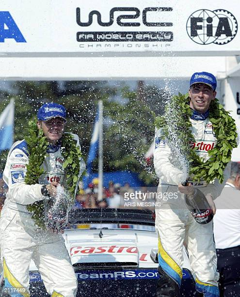 Estonian Markko Martin and his codriver Michael Park celebrate their win opening champagne at the 50th Acropolis rally in Lamia 8 June 2003 Martin...