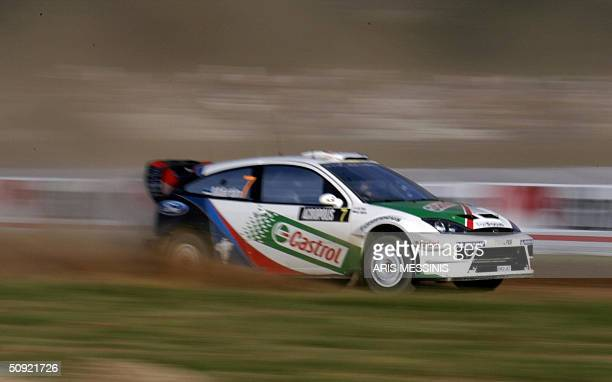 Estonian Markko Martin and his codriver Michael Park steer with their Ford Focus RS WRC 04 during the Acropolis rally of Greece in Lilea special...