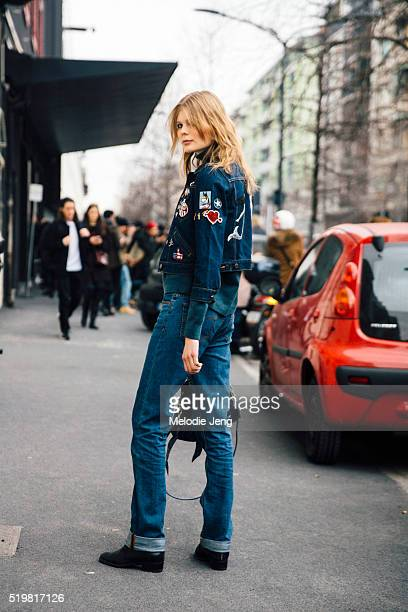 Estonian model Alexandra Elizabeth Ljadov exits the Etro show in a denim on denim looks with a denim patchwork jacket and cuffed jeans during the...