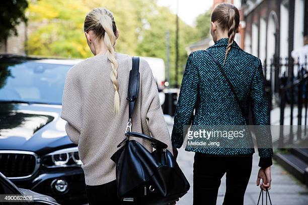 Estonian models Harleth Kuusik and Alexandra Ljadov exit the JW Anderson show during London Fashion Week Spring Summer 2016 at Yeomanry House on...