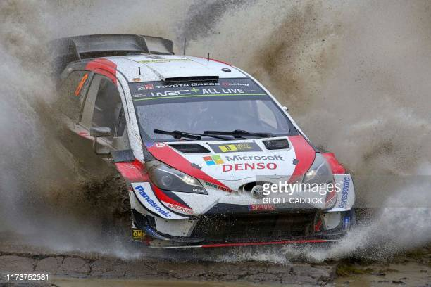 Estonian pilot Ott Tanak and co pilot Martin Jarveoja drive their Toyota Yaris WRC as they compete in the Sweet Lamb stage of the Wales Rally GB the...