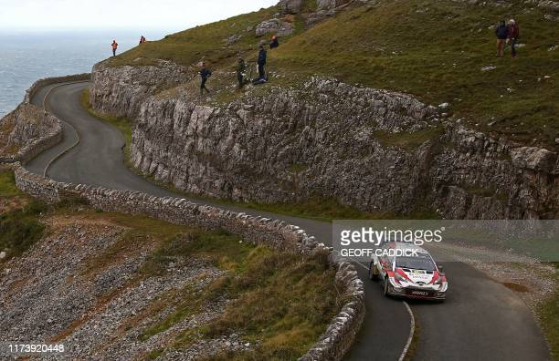 Estonian pilot Ott Tanak and co pilot Martin Jarveoja drive their Toyota Yaris WRC as they pass through the cancelled Great Orme stage of the Wales...