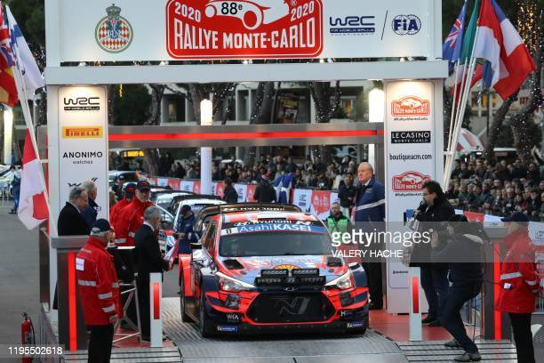 Estonian rally driver Ott Tanak and codriver Martin Jarveoja in their Hyundai take to the departure line at the start of the 88th annual MonteCarlo...