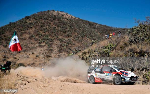 Estonian rally driver Ott Tanak and codriver Martin Jarveoja of Toyota Gazoo Racing WRT compete during the first stage of the FIA World Rally...