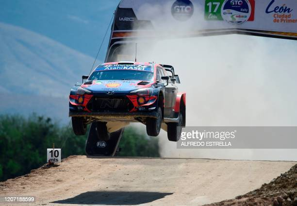 TOPSHOT Estonian rally driver Ott Tanak and his Estonian codriver Martin Jarveoja of the Hyundai i20 Coupe WRC drive compete during the third stage...