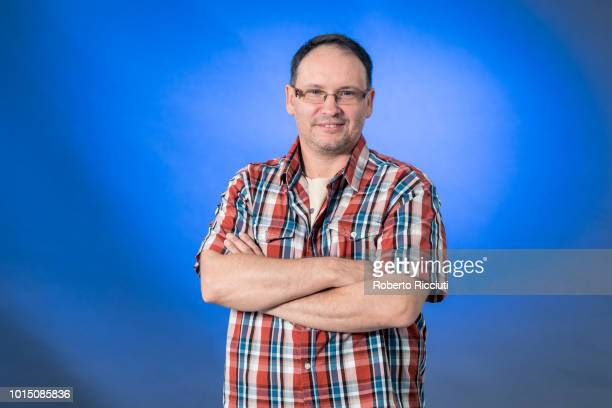 Estonian screenwriter Andrei Ivanov attends a photocall during the annual Edinburgh International Book Festival at Charlotte Square Gardens on August...