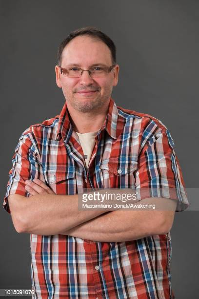 Estonian screenwriter Andrei Ivanov attends a photocall during the Edinburgh International Book Festival on August 11 2018 in Edinburgh Scotland