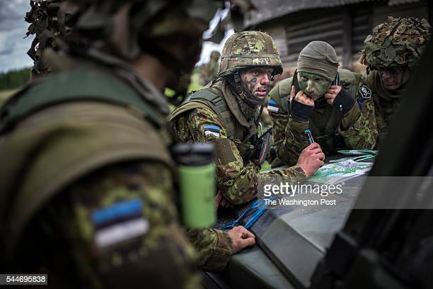 Estonian Special Forces soldiers seen reading the area map after raiding the woods in frames of 5500 large NATO troop exercise in Estonia The troops...