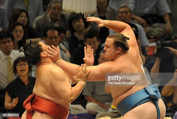 Estonian wrestler Baruto and Mongolian wrestler Akasekiryu compete during day four of the Grand Sumo Nagoya Tournament at Aichi Prefecture Gymnasuim...