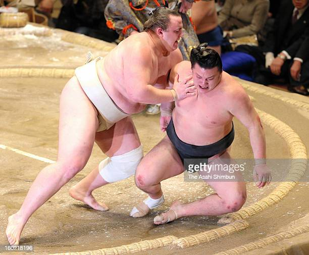 Estonian wrestler Baruto whose real name is Kaido Hoovelson pushes out Ikioi to win during day fifteen of the Grand Sumo New Year Tournament at...