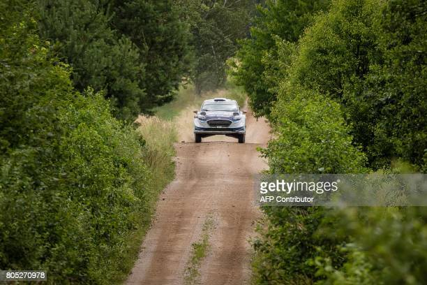 Estonians Ott Tanak and his codriver Martin Jarveoja steer their Ford Fiesta WRC during the special stage of the Orlen Rally Poland in Pozezdrze on...