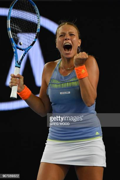 Estonia's Anett Kontaveit celebrates after victory in her women's singles third round match against Latvia's Jelena Ostapenko on day five of the...