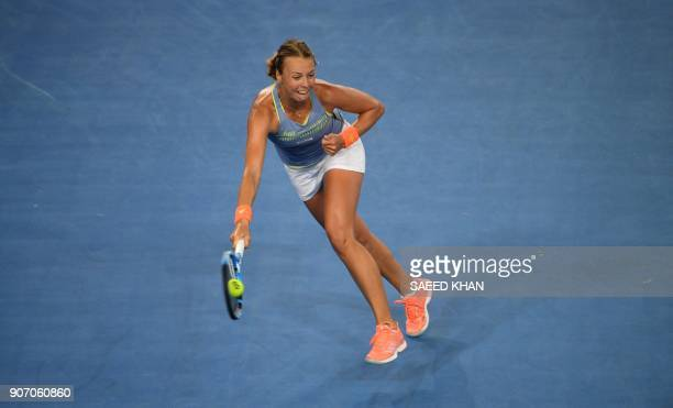 Estonia's Anett Kontaveit plays a forehand return during her women's singles third round match against Latvia's Jelena Ostapenko on day five of the...