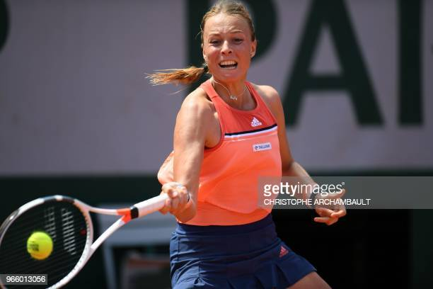 Estonia's Anett Kontaveit plays a forehand return to Czech Republic's Petra Kvitová during their women's singles third round match on day seven of...