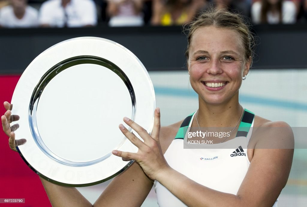 Estonia's Anett Kontaveit poses with the trophy after winning the ladies final tennis match of the Ricoh Open Tennis tournament against Russia's Natalia Vikhlyantseva in Rosmalen, The Netherlands, on June 18, 2017. / AFP PHOTO / ANP / Koen Suyk / Netherlands OUT