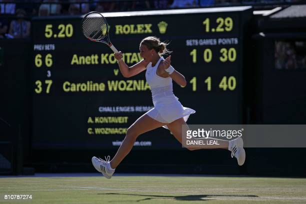 Estonia's Anett Kontaveit returns against Denmark's Caroline Wozniacki during their women's singles third round match on the sixth day of the 2017...