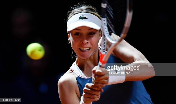 Estonia's Anett Kontaveit returns the ball to Czech Republic's Petra Kvitova during the final match at the WTA Tennis Grand Prix in Stuttgart,...