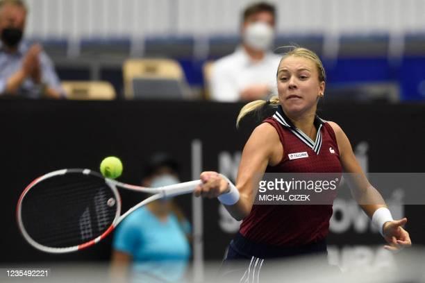 Estonia's Anett Kontaveit returns the ball to Czech Republic's Petra Kvitova in their women's singles semi-final match of the Ostrava Open WTA tennis...