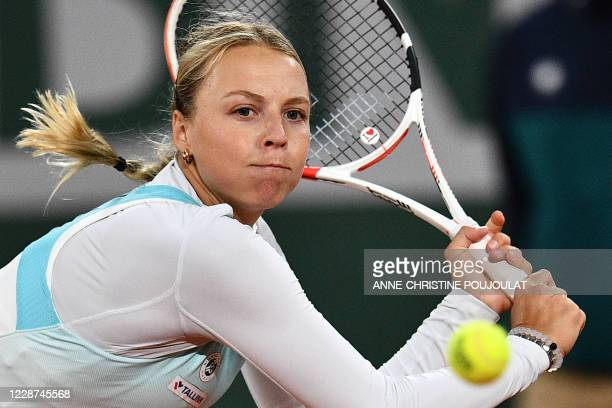 Estonia's Anett Kontaveit returns the ball to France's Caroline Garcia during their women's singles first round tennis match on Day 1 of The Roland...