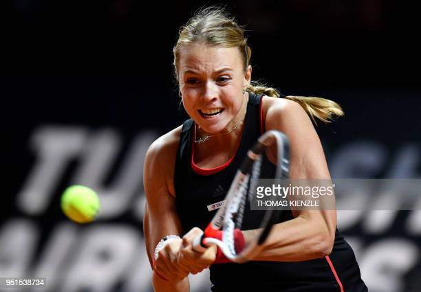 Estonia's Anett Kontaveit returns the ball to Germany's Angelique Kerber during the WTA Porsche Tennis Grand Prix in Stuttgart southwestern Germany...