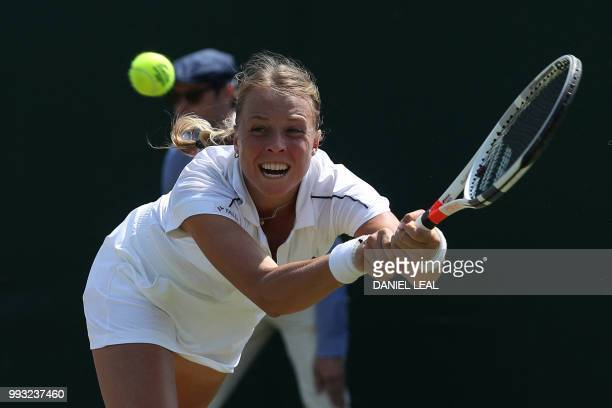 TOPSHOT Estonia's Anett Kontaveit returns to Belgium's Alison van Uytvanck in their women's singles third round match on the sixth day of the 2018...