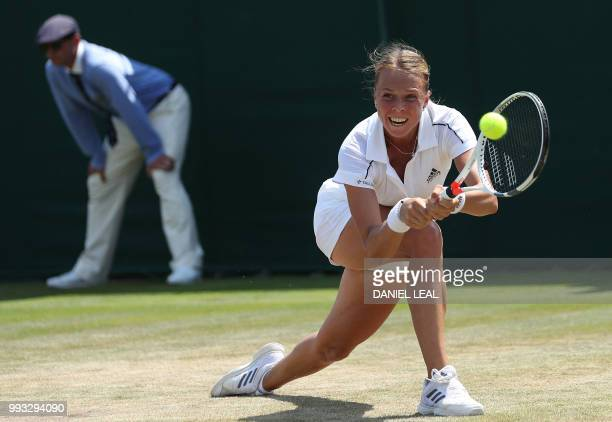 Estonia's Anett Kontaveit returns to Belgium's Alison van Uytvanck in their women's singles third round match on the sixth day of the 2018 Wimbledon...