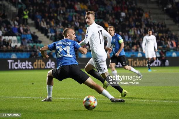 Estonia's defender Nikita Baranov and Germany's forward Marco Reus vie for the ball during the Euro 2020 qualifier Group C Estonia v Germany in...