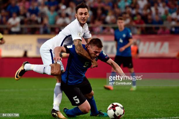 Estonia's Dmitri Kruglov vies with Greece's Tasos Donis during the 2018 FIFA World Cup qualifying football match between Greece and Estonia at the...