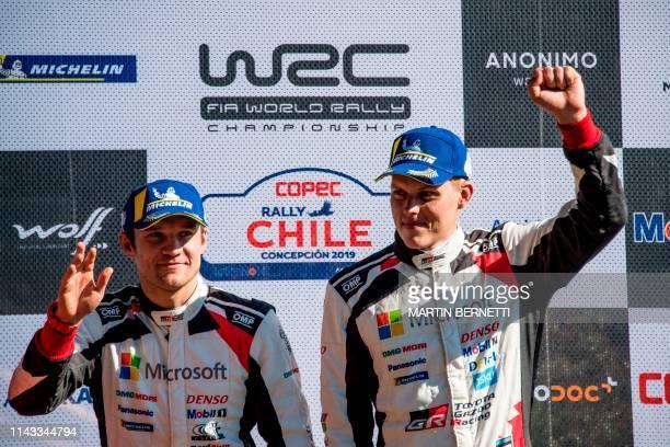 Estonia's Driver Ott Tanak and his compatriot codriver Martin Jarveoja celebrate on the final podium of the WRC Chile 2019 in Concepcion Chile on May...