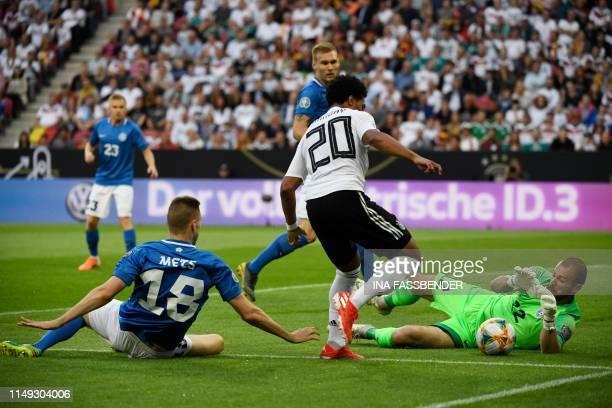 Estonia's goalkeeper Sergei Lepmetz stops the attempt on goal by Germany's forward Serge Gnabry during the UEFA Euro 2020 qualifier Group C football...