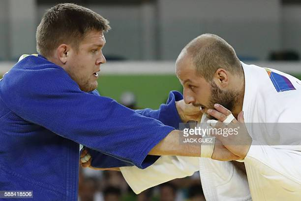Estonia's Grigori Minaskin competes with Kazakhstan's Maxim Rakov during their men's 100kg judo contest match of the Rio 2016 Olympic Games in Rio de...